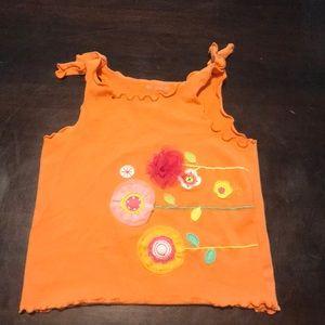 Baby's orange tank top!